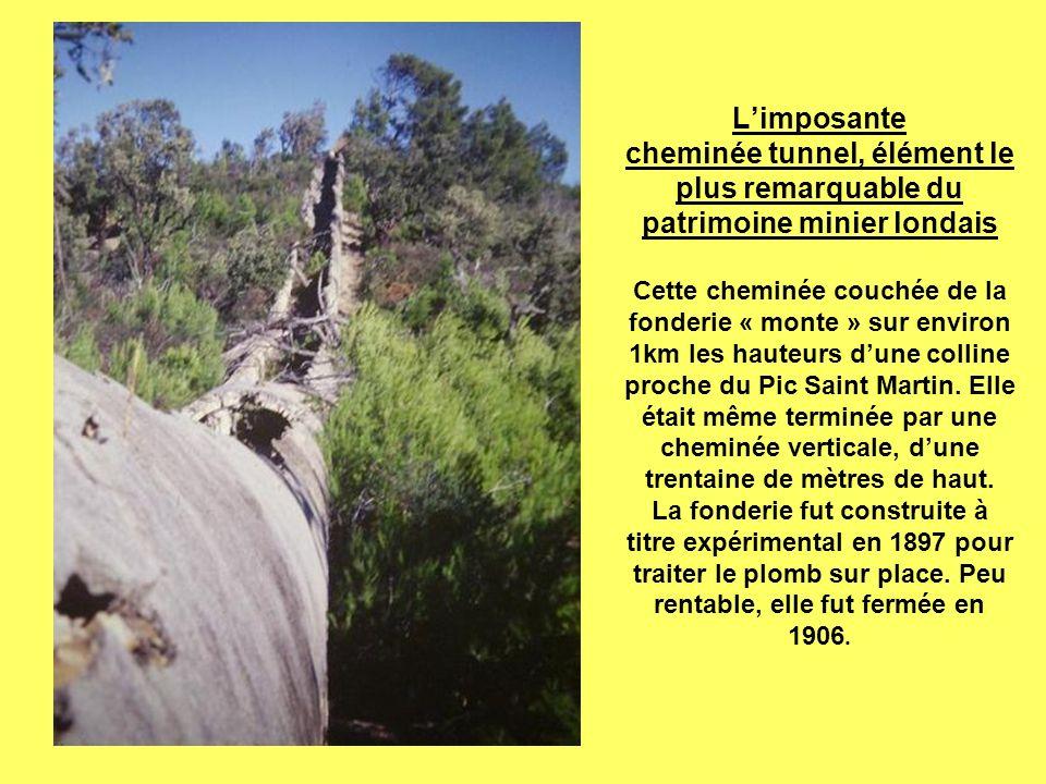 Limposante cheminée tunnel, élément le plus remarquable du patrimoine minier londais Cette cheminée couchée de la fonderie « monte » sur environ 1km les hauteurs dune colline proche du Pic Saint Martin.