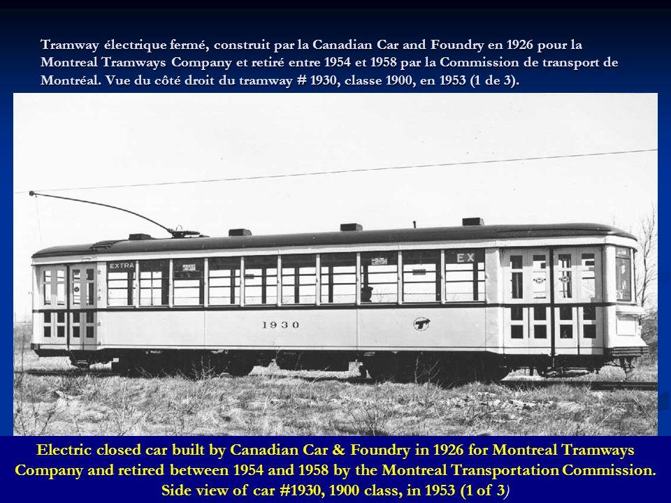 Vue du square Victoria à partir de la rue Saint-Jacques, avec à lavant-plan une voie de tramways de la Commission de transport de Montréal, en 1952 (2