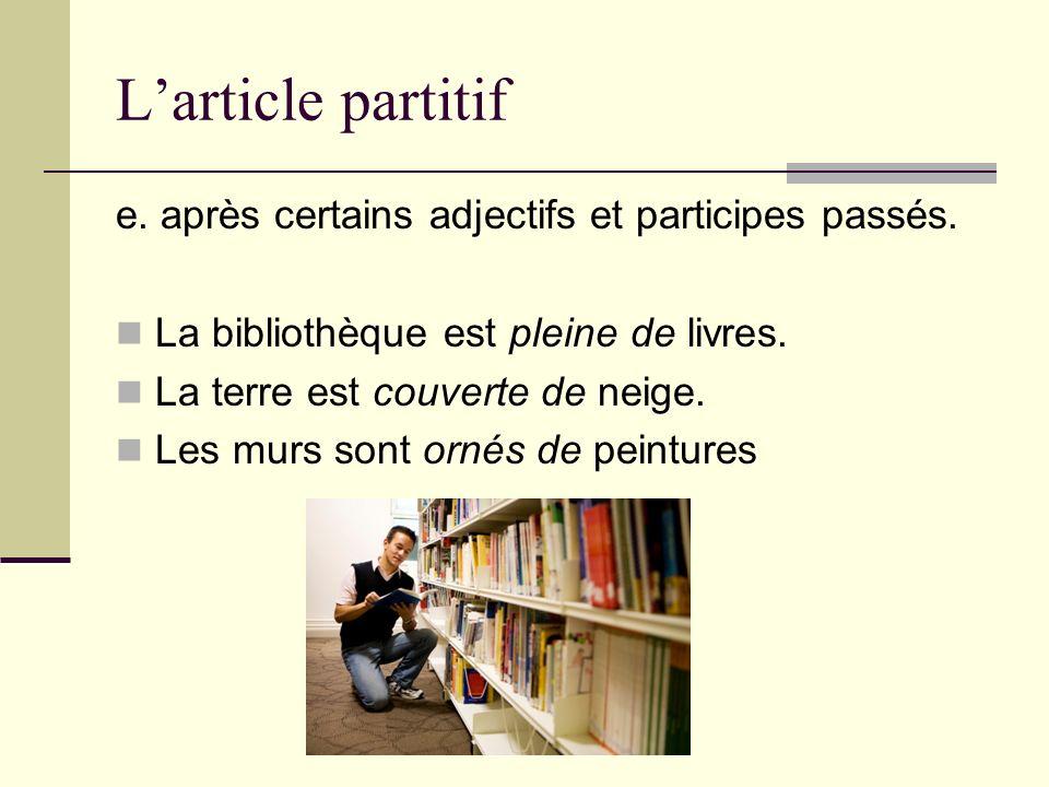 Larticle partitif e. après certains adjectifs et participes passés. La bibliothèque est pleine de livres. La terre est couverte de neige. Les murs son