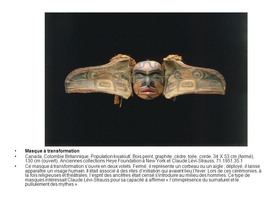 Masque à transformation Canada, Colombie Britannique, Population kwakiutl, Bois peint, graphite, cèdre, toile, corde, 34 X 53 cm (fermé), 130 cm (ouve