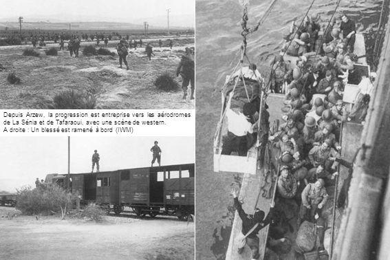 Depuis Arzew, la progression est entreprise vers les aérodromes de La Sénia et de Tafaraoui, avec une scène de western. A droite : Un blessé est ramen