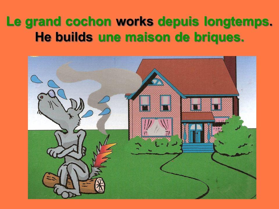 Le grand cochon works depuis longtemps. He builds une maison de briques.