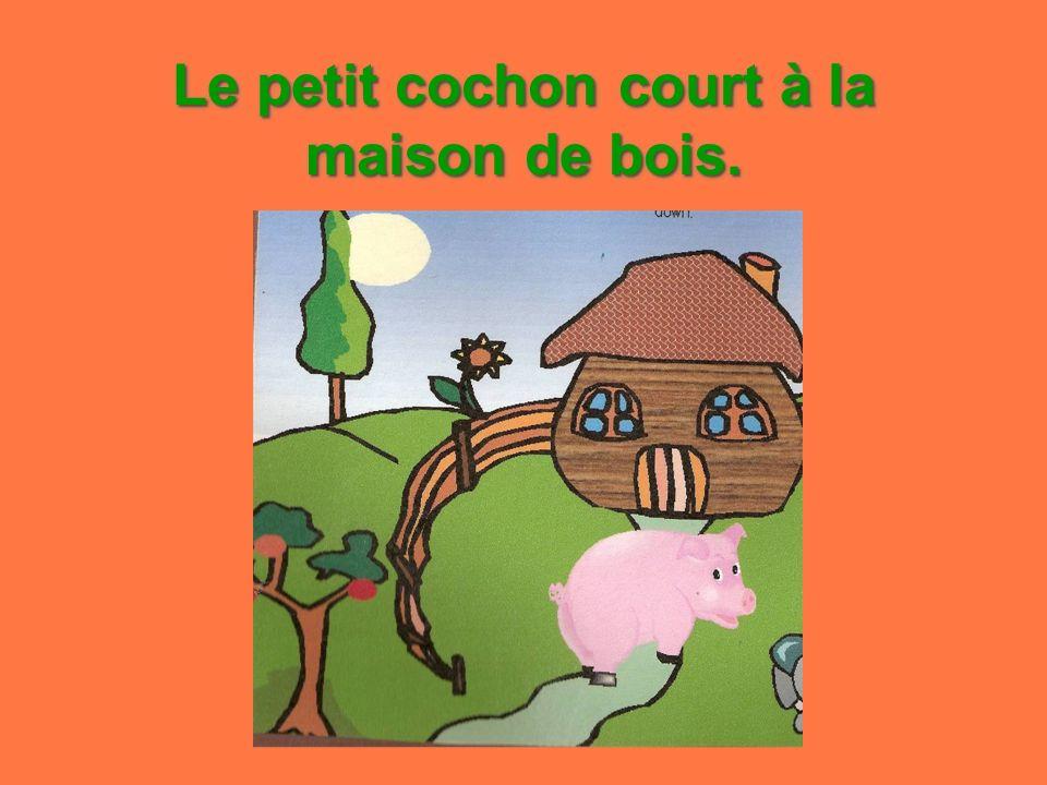 Le petit cochon court à la maison de bois.
