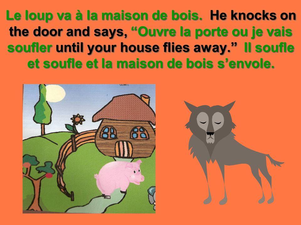 Le loup va à la maison de bois.