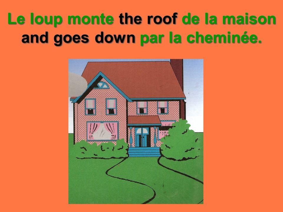 Le loup monte the roof de la maison and goes down par la cheminée.