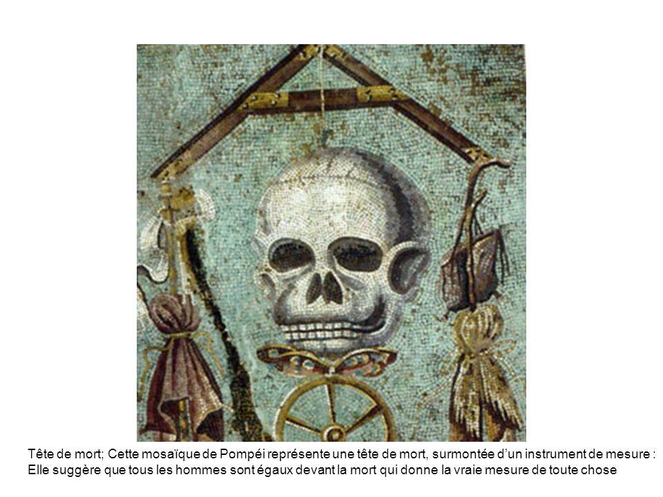 Tête de mort; Cette mosaïque de Pompéi représente une tête de mort, surmontée dun instrument de mesure : Elle suggère que tous les hommes sont égaux d