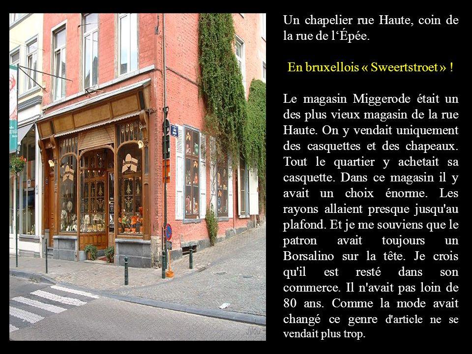 Un chapelier rue Haute, coin de la rue de lÉpée.En bruxellois « Sweertstroet » .
