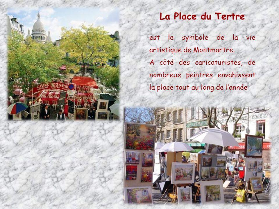 Le lapin agile Petite maison rose située au pied des vignes de Montmartre.