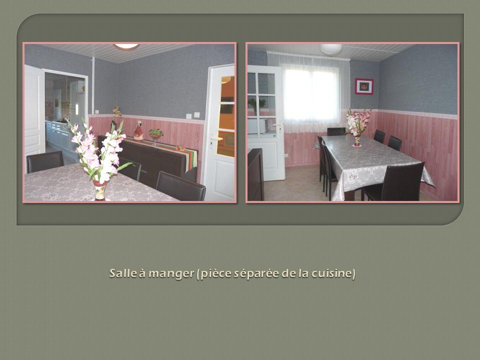 (photos 1 et 2 ) : Cuisine intégrée (23 m2) avec nom- breux éléments de rangement.