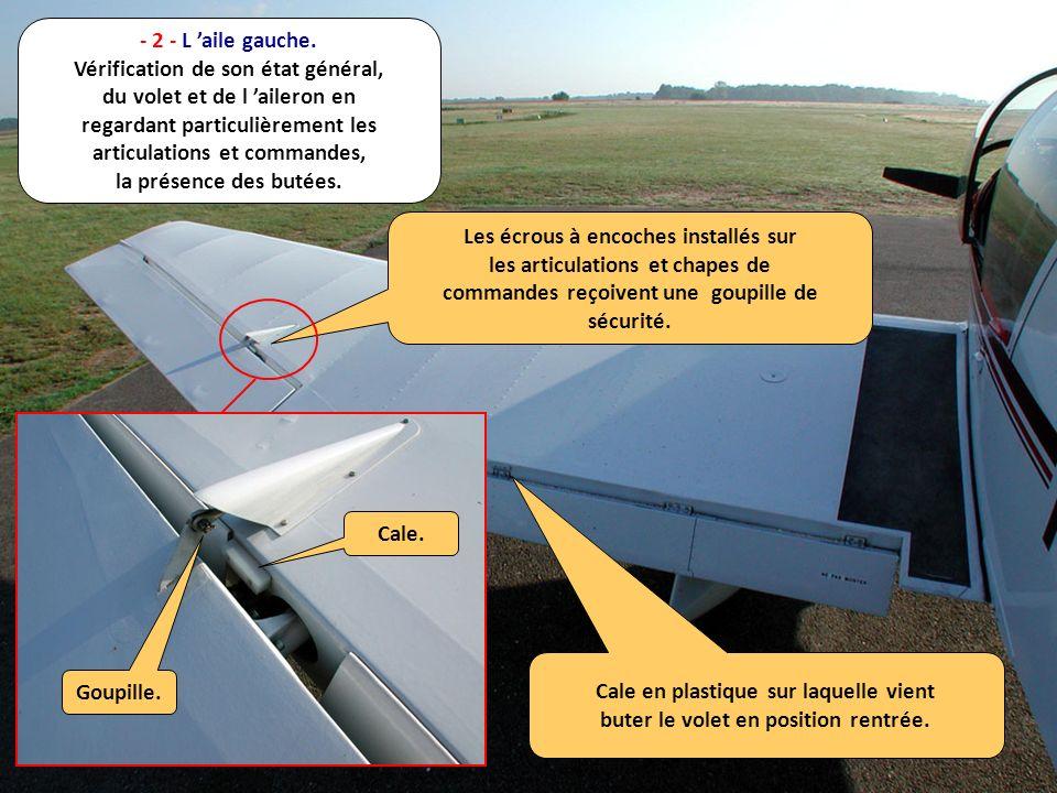 - 2 - L aile gauche. Vérification de son état général, du volet et de l aileron en regardant particulièrement les articulations et commandes, la prése