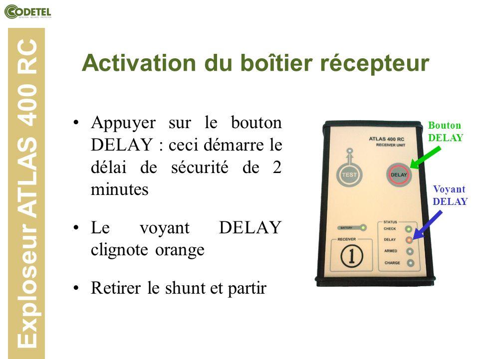 Activation du boîtier récepteur Appuyer sur le bouton DELAY : ceci démarre le délai de sécurité de 2 minutes Le voyant DELAY clignote orange Retirer l