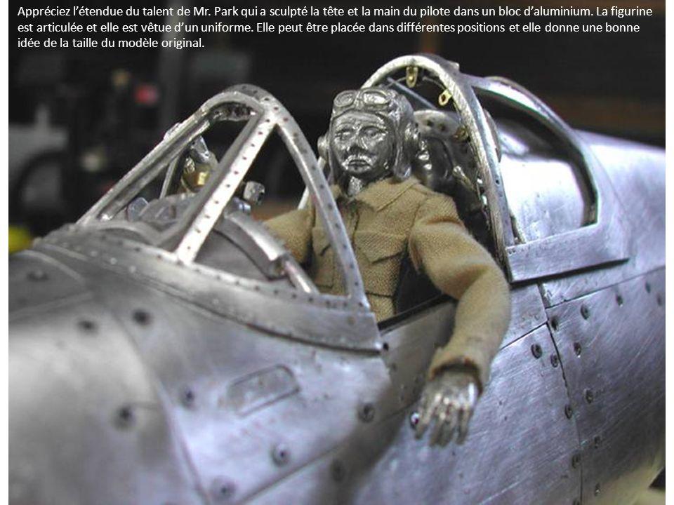 Appréciez létendue du talent de Mr. Park qui a sculpté la tête et la main du pilote dans un bloc daluminium. La figurine est articulée et elle est vêt