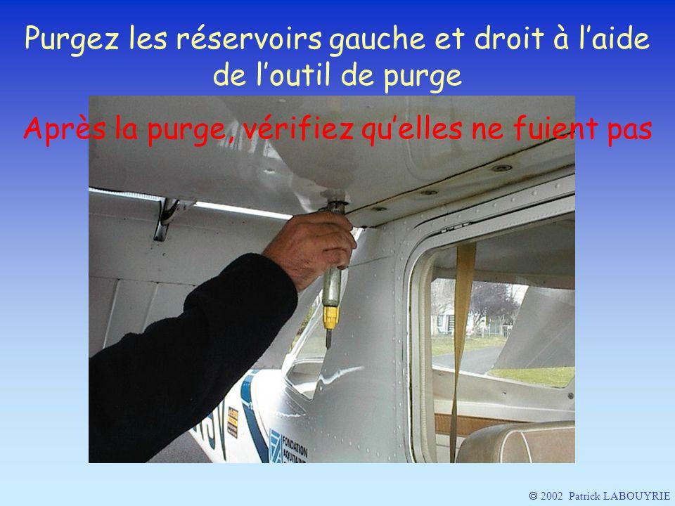 Purgez les réservoirs gauche et droit à laide de loutil de purge Après la purge, vérifiez quelles ne fuient pas 2002 Patrick LABOUYRIE