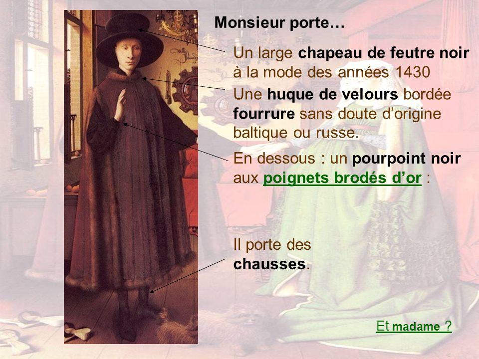 Un large chapeau de feutre noir à la mode des années 1430 Monsieur porte… Une huque de velours bordée fourrure sans doute dorigine baltique ou russe.