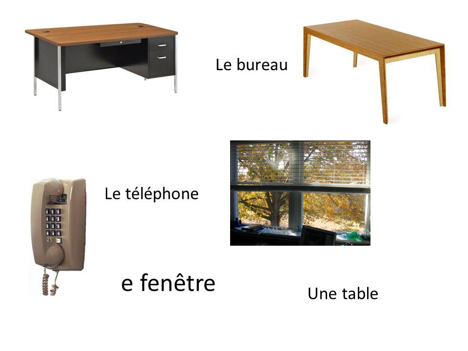 Une fenêtre Une table Le téléphone Le bureau