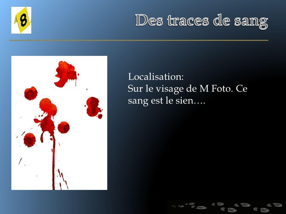 Localisation: Sur le visage de M Foto. Ce sang est le sien….