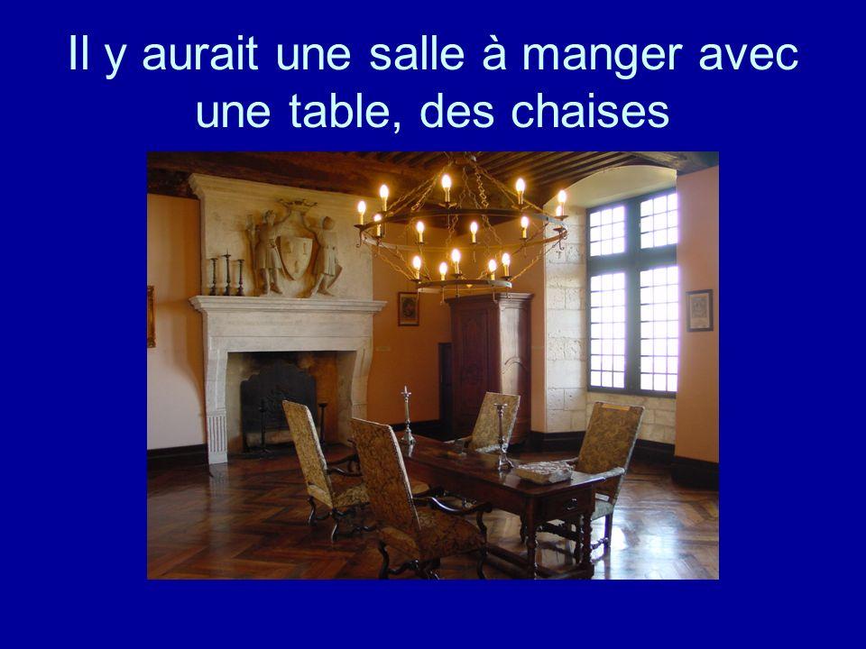 Il y aurait une salle à manger avec une table, des chaises