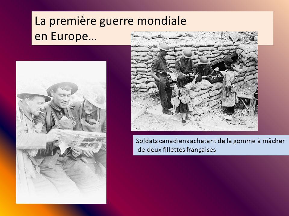 Soldats canadiens achetant de la gomme à mâcher de deux fillettes françaises La première guerre mondiale en Europe…
