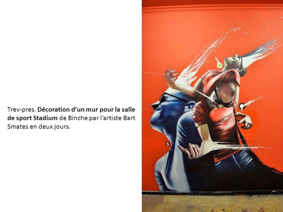 Trev-pres. Décoration dun mur pour la salle de sport Stadium de Binche par lartiste Bart Smates en deux jours.