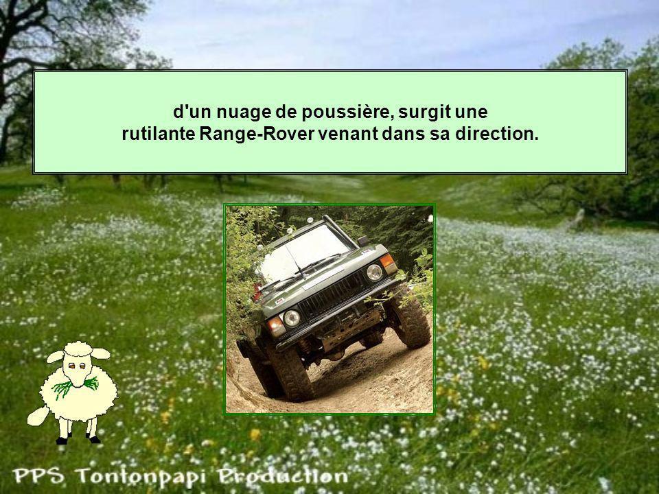 d un nuage de poussière, surgit une rutilante Range-Rover venant dans sa direction.