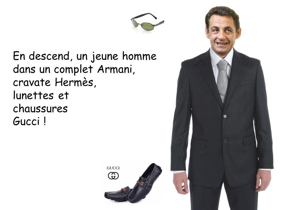 En descend, un jeune homme dans un complet Armani, cravate Hermès, lunettes et chaussures Gucci !