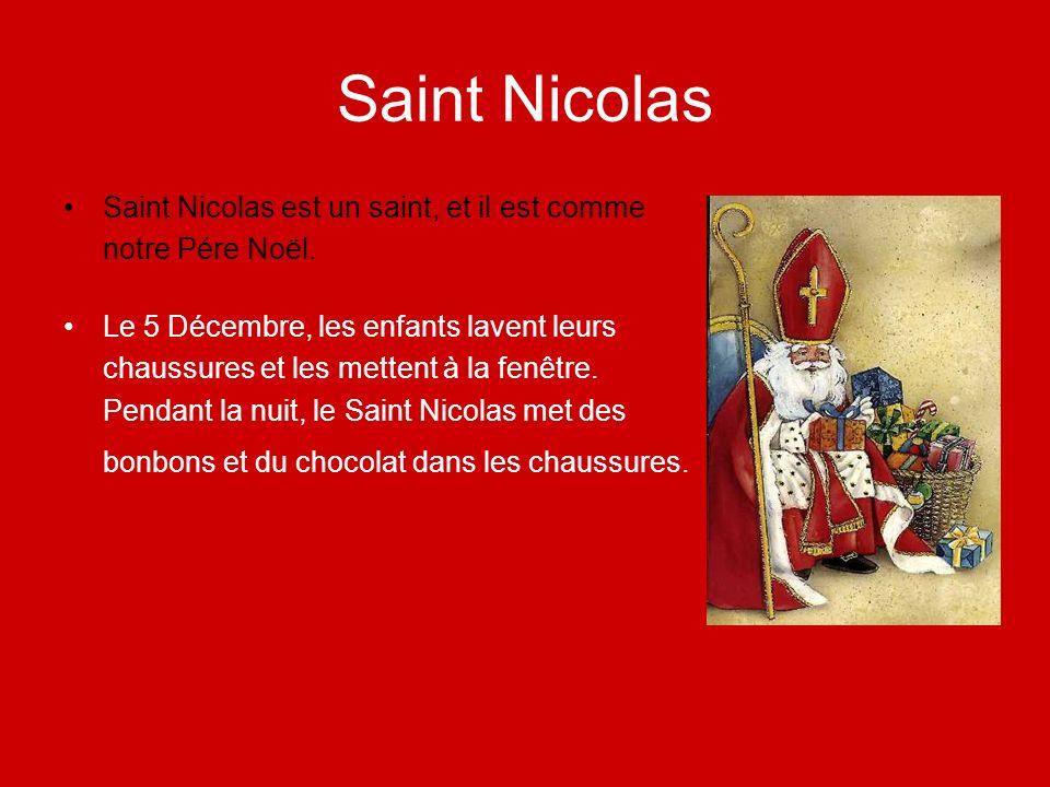 Saint Nicolas Saint Nicolas est un saint, et il est comme notre Pére Noël. Le 5 Décembre, les enfants lavent leurs chaussures et les mettent à la fenê