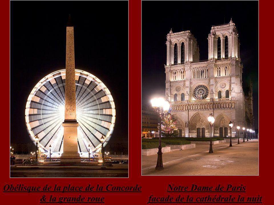 Grande Arche de la Défense illuminée et reflets dans la fontaine