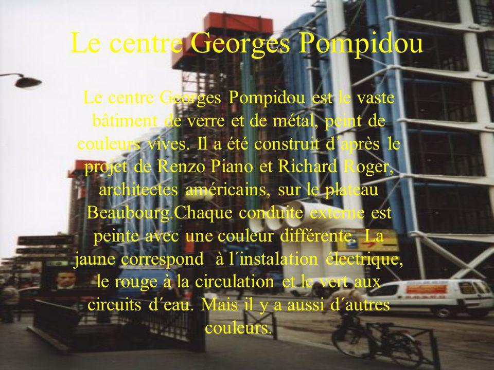 Le centre Georges Pompidou Le centre Georges Pompidou est le vaste bâtiment de verre et de métal, peint de couleurs vives. Il a été construit d´après