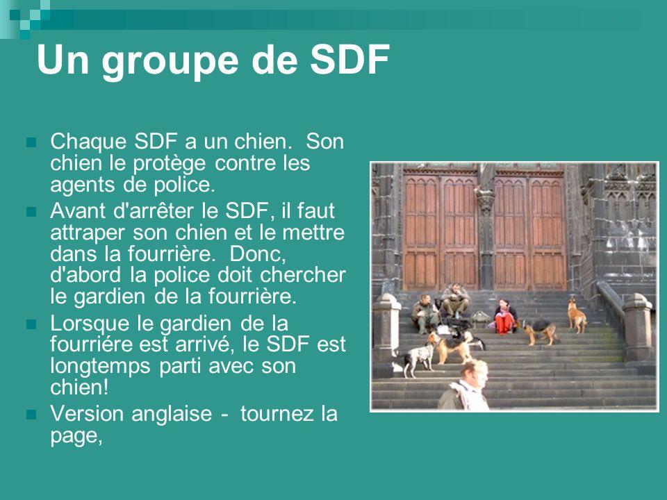 Un groupe de SDF Chaque SDF a un chien. Son chien le protège contre les agents de police.