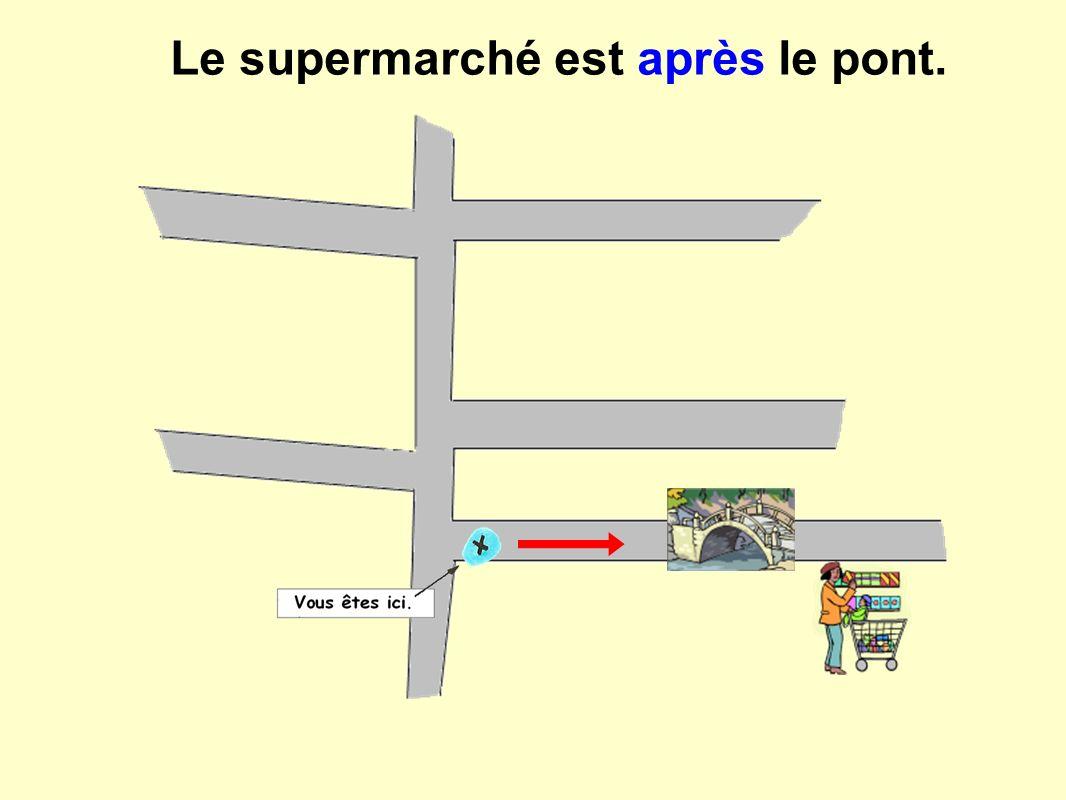 Le supermarché est après le pont.