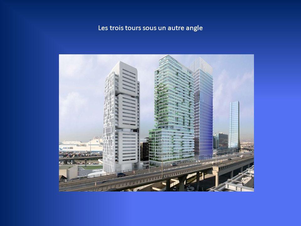 - A gauche, la tour de Jean Nouvel, qui vient de remporter le Pritzker Price, considéré comme le Nobel de l'architecture. 130 m de haut, 30 étages de