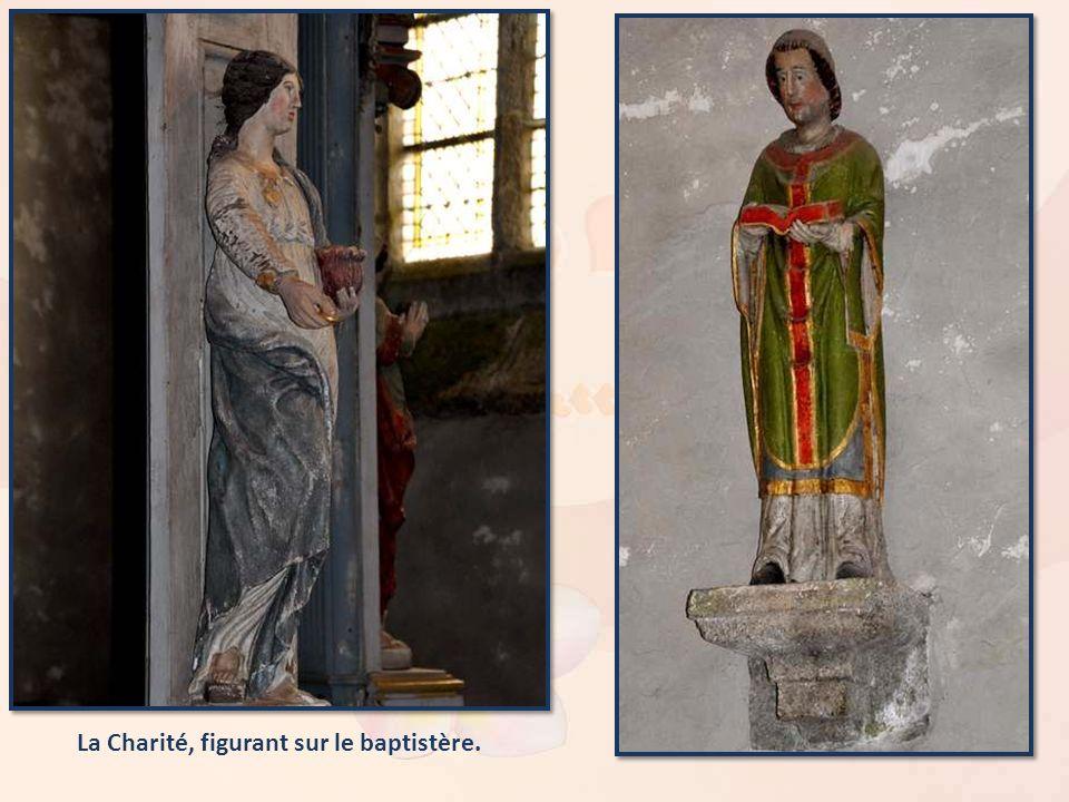 La Charité, figurant sur le baptistère.
