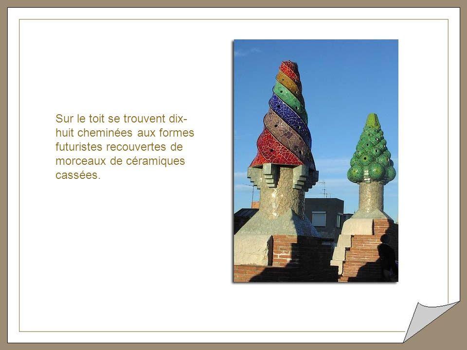Sur le toit se trouvent dix- huit cheminées aux formes futuristes recouvertes de morceaux de céramiques cassées.