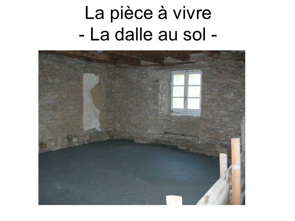 La pièce à vivre - La dalle au sol -