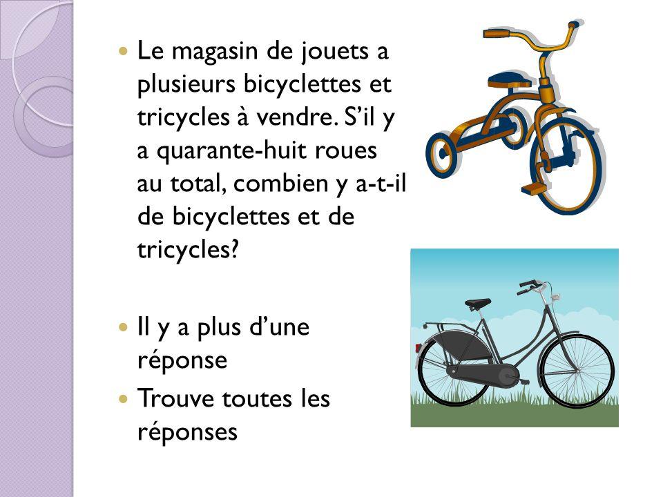 Le magasin de jouets a plusieurs bicyclettes et tricycles à vendre.
