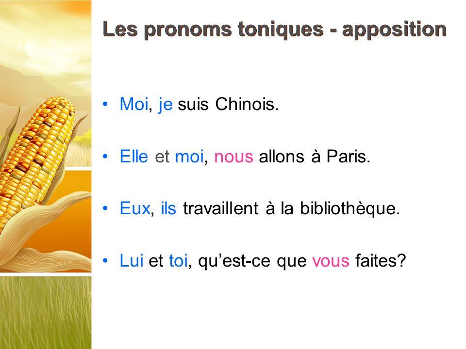Les pronoms toniques - apposition Moi, je suis Chinois. Elle et moi, nous allons à Paris. Eux, ils travaillent à la bibliothèque. Lui et toi, quest-ce