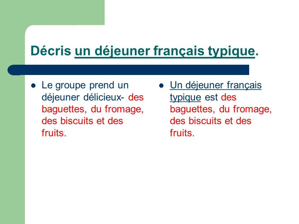 Décris un déjeuner français typique. Le groupe prend un déjeuner délicieux- des baguettes, du fromage, des biscuits et des fruits. Un déjeuner françai