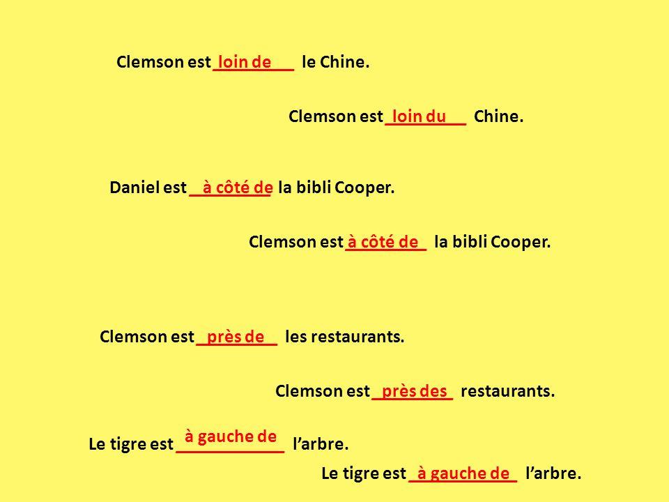 Clemson est _________ les restaurants. près de Clemson est _________ restaurants. près des Daniel est _________ la bibli Cooper. à côté de Clemson est