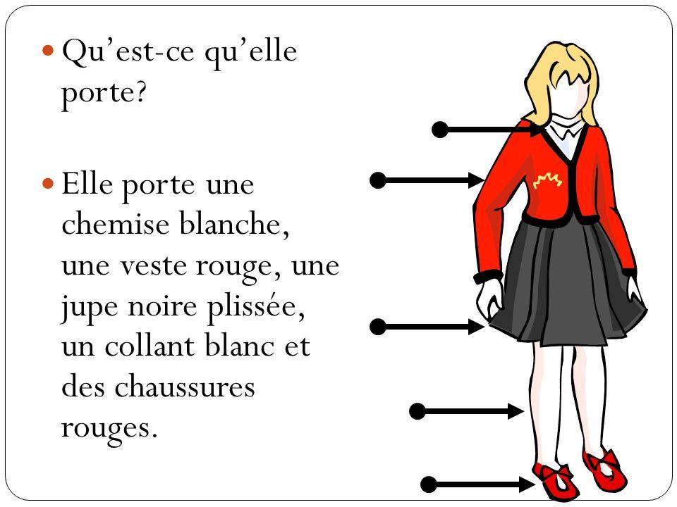 Quest-ce quelle porte? Elle porte une chemise blanche, une veste rouge, une jupe noire plissée, un collant blanc et des chaussures rouges.