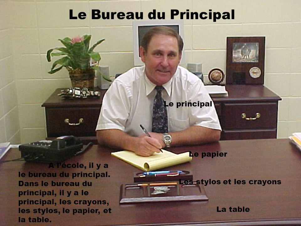 Le Bureau du Principal A lécole, il y a le bureau du principal. Dans le bureau du principal, il y a le principal, les crayons, les stylos, le papier,