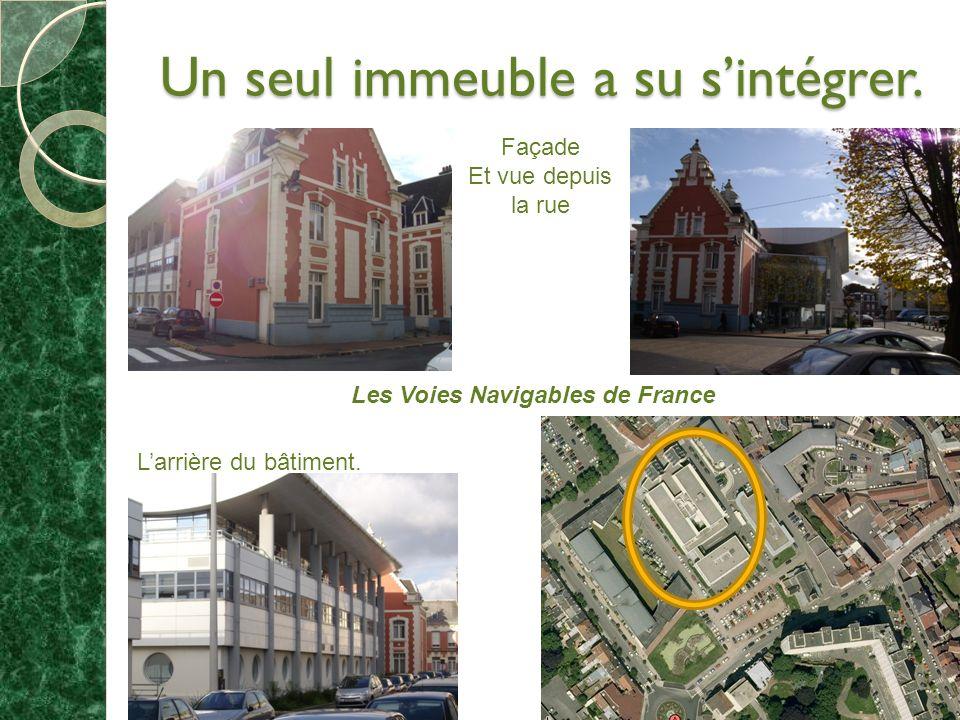 Un seul immeuble a su sintégrer. Façade Et vue depuis la rue Les Voies Navigables de France Larrière du bâtiment.