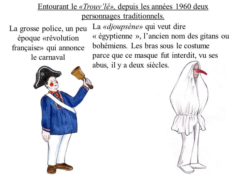 Entourant le «Trouvlê», depuis les années 1960 deux personnages traditionnels.