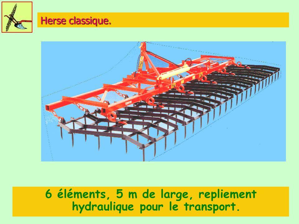 Herse classique. 6 éléments, 5 m de large, repliement hydraulique pour le transport.