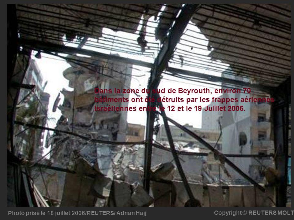 Photo prise le 18 juillet 2006/REUTERS/ Adnan Hajj Copyright © REUTERS MOLT Dans la zone du sud de Beyrouth, environ 70 bâtiments ont été détruits par