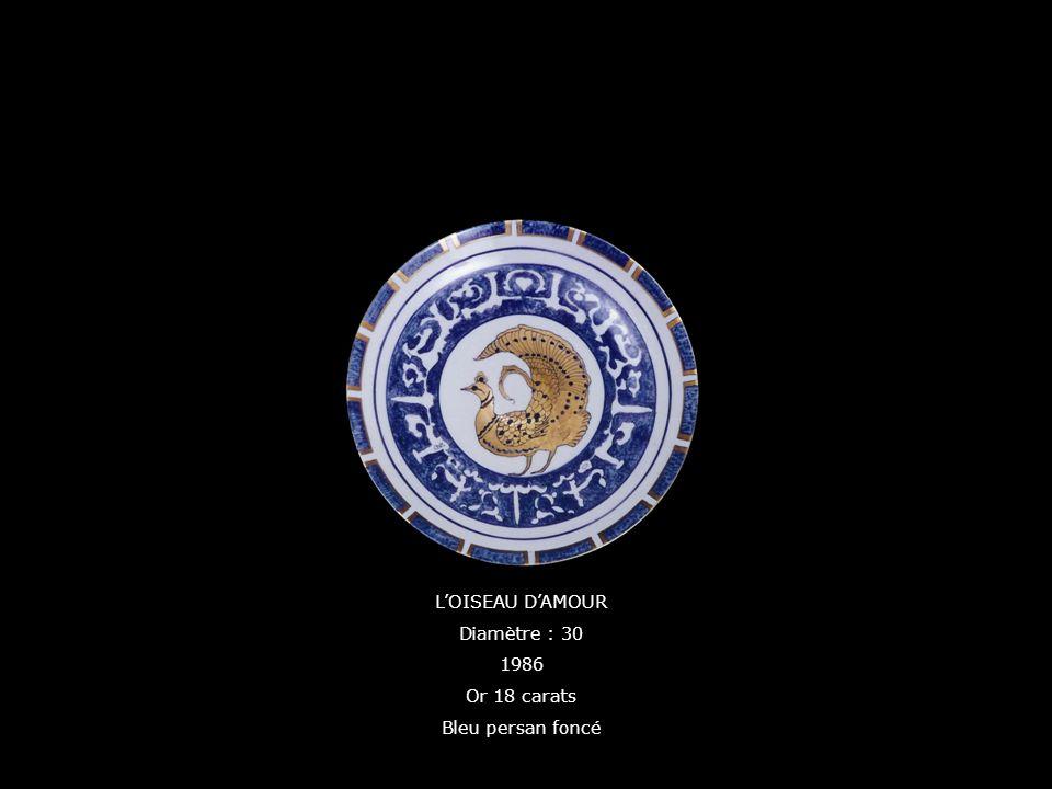 LOISEAU DAMOUR Diamètre : 30 1986 Or 18 carats Bleu persan foncé
