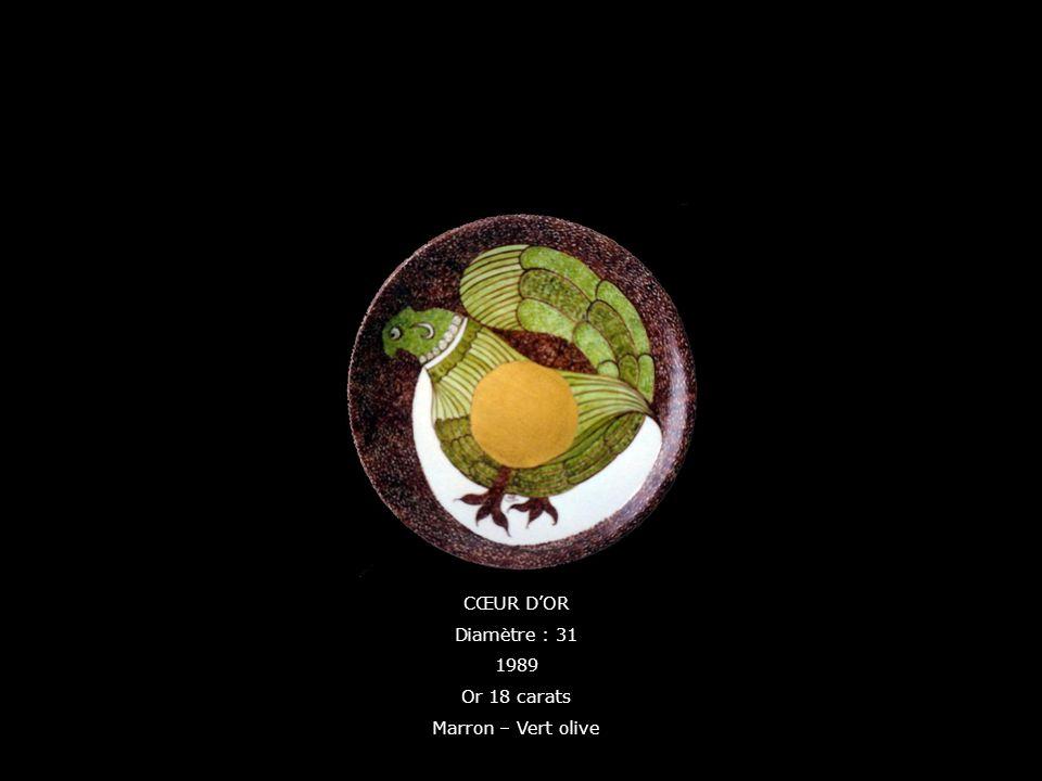 CŒUR DOR Diamètre : 31 1989 Or 18 carats Marron – Vert olive