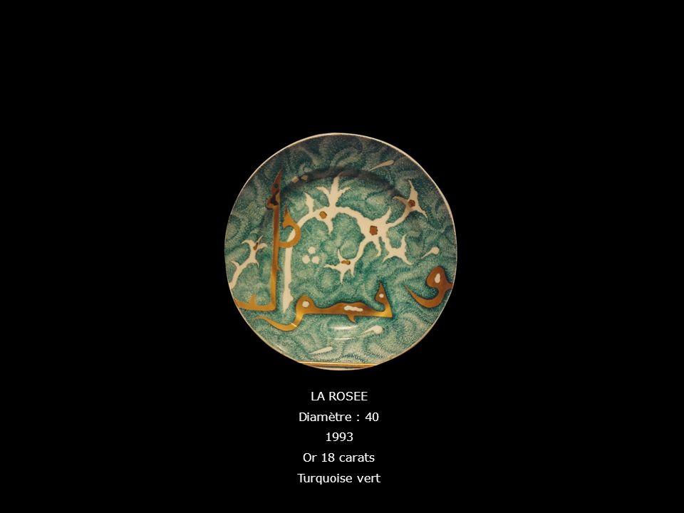 LA ROSEE Diamètre : 40 1993 Or 18 carats Turquoise vert