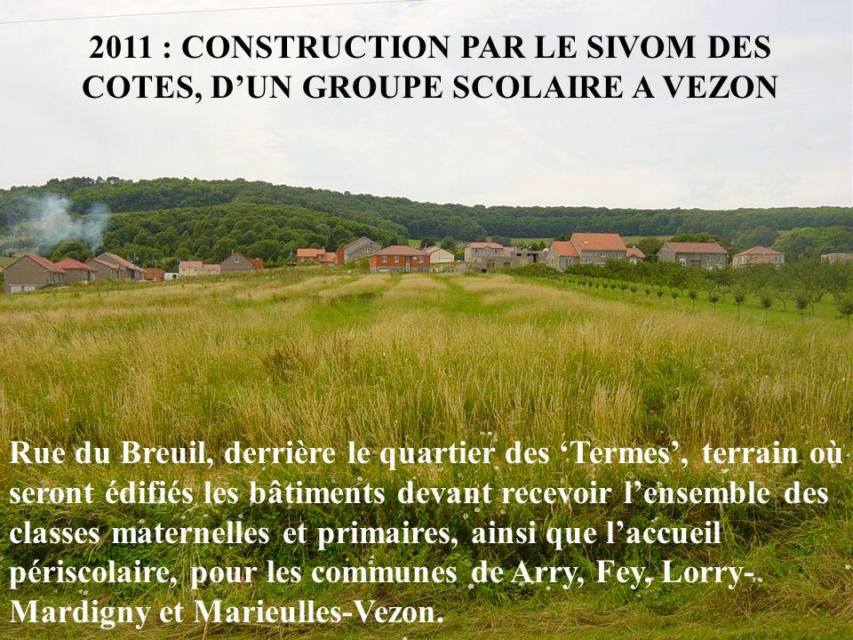 2011 : CONSTRUCTION PAR LE SIVOM DES COTES, DUN GROUPE SCOLAIRE A VEZON Rue du Breuil, derrière le quartier des Termes, terrain où seront édifiés les