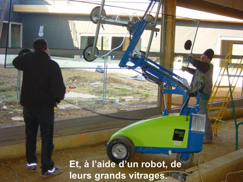 Et, à laide dun robot, de leurs grands vitrages.