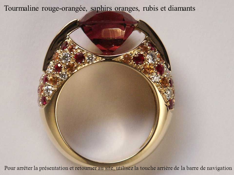 Tourmaline rouge-orangée, saphirs oranges, rubis et diamants Pour arrêter la présentation et retourner au site, utilisez la touche arrière de la barre de navigation